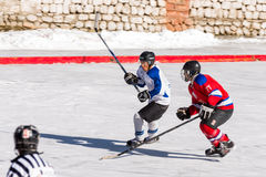 Ice hockey player challenging Stock Image