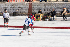 Ice hockey player challenging Stock Images