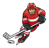 Ice hockey player dribbling Royalty Free Stock Photos