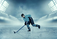 Ice hockey player in equipment poses on stadium. Professional ice hockey player in equipment poses on stadium. Ice-skating. Winter season sport Royalty Free Stock Image