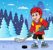 Ice hockey player on frozen lake Royalty Free Stock Images