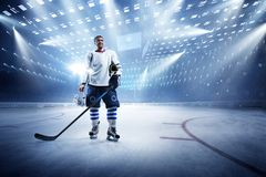 Ice hockey player on the grand ice arena. Hockey player on the grand ice arena royalty free stock image