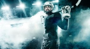 Ice Hockey player in the helmet and gloves on stadium with stick. Hockey player in the mask on stadium royalty free stock photos
