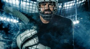 Ice Hockey player in the helmet and gloves on stadium with stick. Hockey player in the mask on stadium stock photos