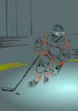 Ice hockey player with hockey stick and puck Stock Photography