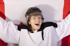 Ice hockey player holding canadian flag Stock Photos
