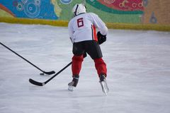 Ice hockey player on the ice. Open stadium - Winter Classic game. royalty free stock photo