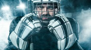 Ice Hockey player in the mask and gloves on stadium with stick. Hockey goalie in the mask stock photos