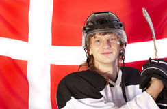 Ice hockey player over denmark flag Stock Photography