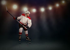 Ice Hockey player ready to make a snapshot