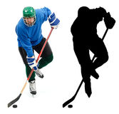 Ice hockey player and it's silhouette Stock Photo