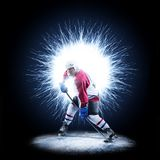 Ice Hockey player is skating on a abstract background stock images
