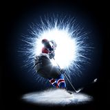 Ice Hockey player is skating on a abstract background. With intensional light Stock Photography