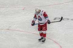 Ice hockey player standing alone stock photography