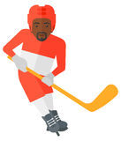 Ice-hockey player with stick. Royalty Free Stock Photo