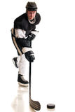 Ice Hockey Player. Studio shot over white royalty free stock photo
