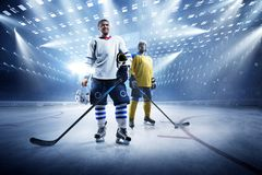 Ice hockey players on the grand ice arena. Hockey players on the grand ice arena royalty free stock photo