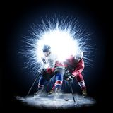 Ice Hockey players are skating on a abstract background stock image