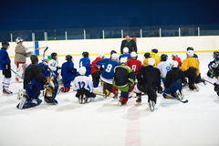 Ice hockey players team meeting with trainer. Ice hockey players team group meeting with trainer  in sport arena indoors Royalty Free Stock Image