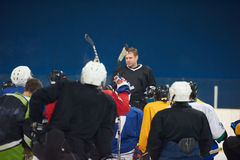 Ice hockey players team meeting with trainer Royalty Free Stock Photo