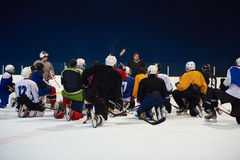 Ice hockey players team meeting with trainer Stock Image