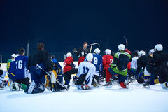 Ice hockey players team meeting with trainer Stock Photos