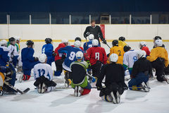 Ice hockey players team meeting with trainer Royalty Free Stock Image