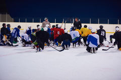 Ice hockey players team meeting with trainer Stock Photo