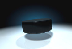 Ice hockey puck. Flying ice hockey puck on ice Royalty Free Stock Image