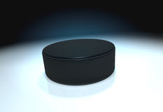 Ice hockey puck. On ice Stock Image