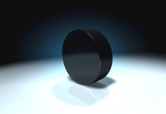 Ice hockey puck. On ice Royalty Free Stock Photos