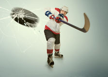 Ice hockey puck hit the opponent visor Stock Photos