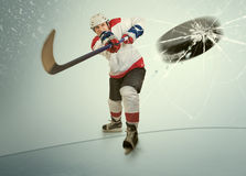Ice hockey puck hit the opponent visor Stock Images