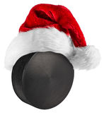 Ice hockey puck santa hat Royalty Free Stock Image