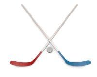 Ice Hockey puck and sticks. Stock Photos