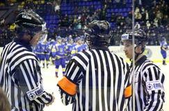 Ice-hockey referees in action. KYIV, UKRAINE - FEBRUARY 09, 2012: Ice-hockey referees in action during Euro Hockey Challenge game between Ukraine and Romania on Stock Image