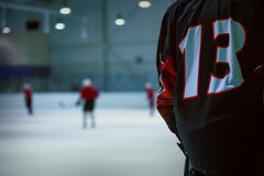 Ice hockey reserve player number 13 ready to play Royalty Free Stock Images