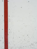 Ice hockey rink boards. Background with puck marks Stock Photo