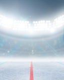 Ice Hockey Rink Stadium. A generic ice hockey ice rink stadium with a frozen surface under illuminated floodlights Stock Images