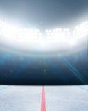 Ice Hockey Rink Stadium. A generic ice hockey ice rink stadium with a frozen surface under illuminated floodlights Stock Image