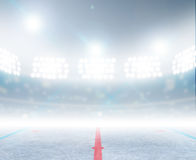Ice Hockey Rink Stadium. A generic ice hockey ice rink stadium with a frozen surface under illuminated floodlights Royalty Free Stock Photography