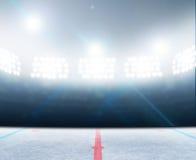 Ice Hockey Rink Stadium. A generic ice hockey ice rink stadium with a frozen surface under illuminated floodlights Royalty Free Stock Photos