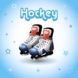 Ice hockey skates,. Ice hockey skates on a blue background Stock Photos