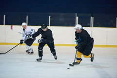 Ice hockey sport players. In action, business comptetition concpet Stock Images