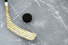 Ice Hockey Stick. A hockey stick and puck on the ice stock image
