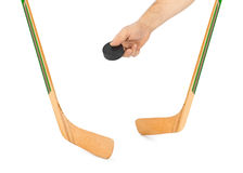 Ice hockey stick and hand with puck Stock Photo