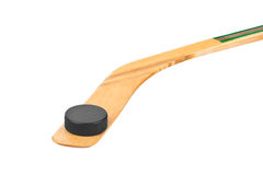 Ice hockey stick and puck. Isolated on white background Stock Images