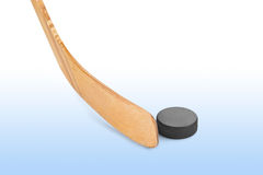Ice hockey stick and puck. Isolated on white background Stock Photos