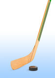 Ice hockey stick and puck. Isolated on white background Stock Photo
