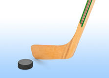 Ice hockey stick and puck. Isolated on white background Royalty Free Stock Photos